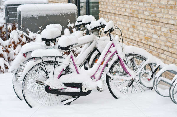 Parked bicycles covered witn snow in winter Stock photo © AlessandroZocc