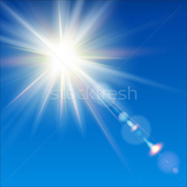 The bright sun shines on a blue sky background. Stock photo © alevtina
