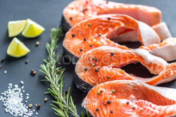 Raw trout steaks on the wooden board Stock photo © Alex9500