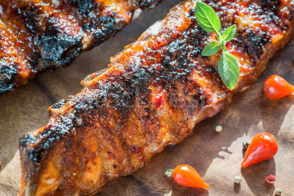 Grilled pork ribs on the wooden board Stock photo © Alex9500