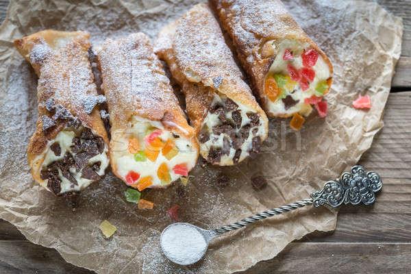 Stock photo: Cannoli stuffed with cream cheese