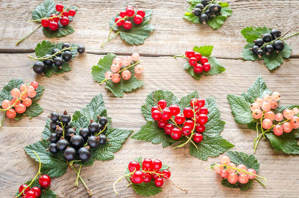 Fresh currant on leaves on the wooden board Stock photo © Alex9500