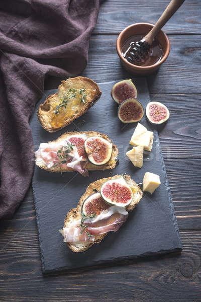 Toasts with bacon and figs Stock photo © Alex9500
