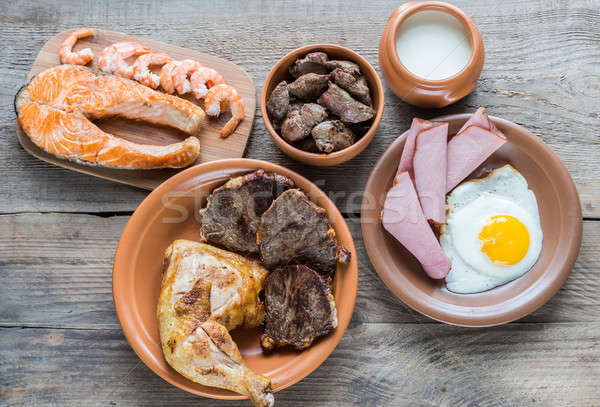 Protein diet:cooked products on the wooden background Stock photo © Alex9500