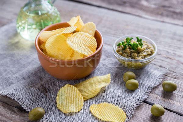 Batatas fritas oliva vidro tigela tabela gordura Foto stock © Alex9500