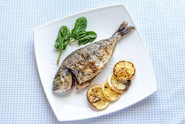 Gegrild vis citroen spinazie voedsel tabel Stockfoto © Alex9500