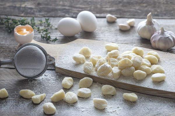 Uncooked potato gnocchi with ingredients Stock photo © Alex9500