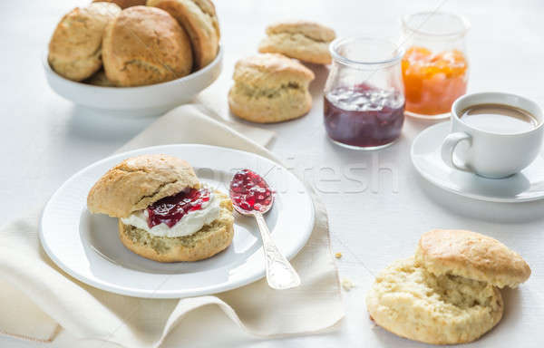 Scones with cream and fruit jam and cup of coffee Stock photo © Alex9500