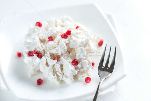 Portion of meringue with pomegranate seeds Stock photo © Alex9500