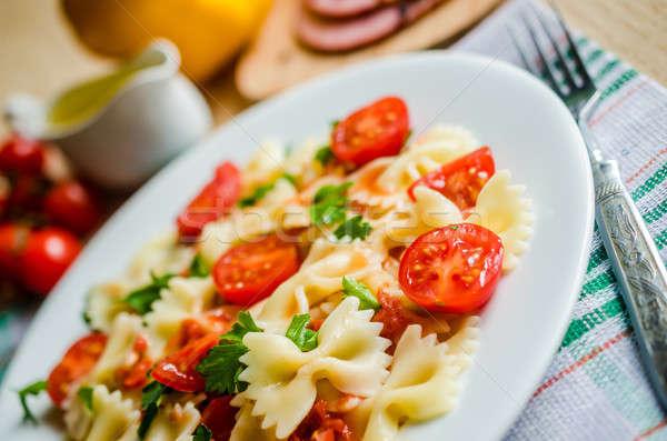 Pasta pomodorini alimentare sfondo arancione ristorante Foto d'archivio © Alex9500