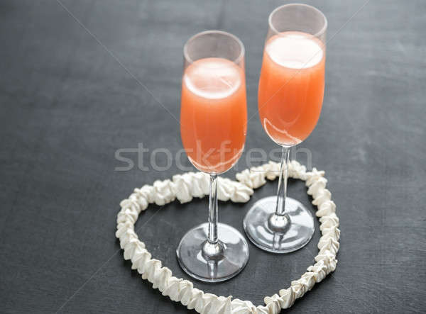 Two bellini cocktails inside of meringue heart Stock photo © Alex9500