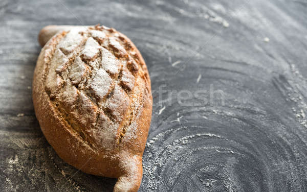 Whole wheat bread on the dark wooden background Stock photo © Alex9500