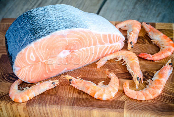 Raw salmon and shrimps on the wooden board Stock photo © Alex9500