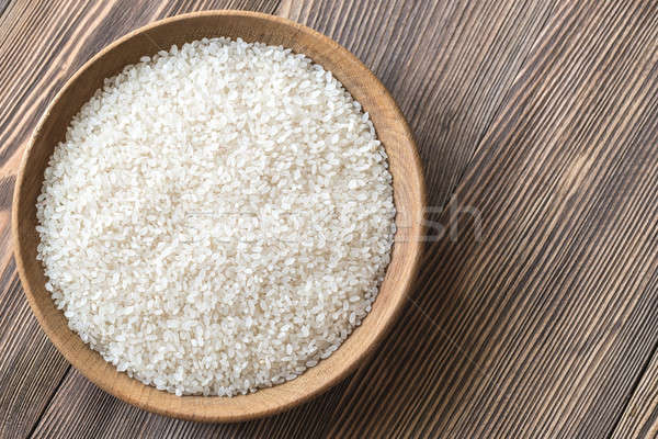 Bowl of uncooked camolino rice Stock photo © Alex9500