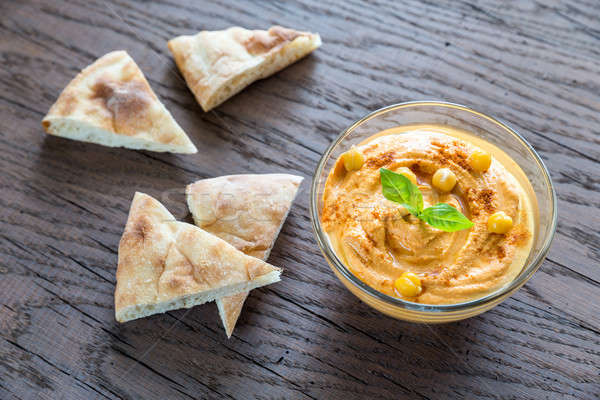 Stock photo: A bowl of hummus with pita slices
