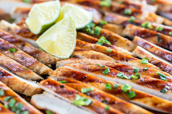 Slices of grilled chicken in lime sauce Stock photo © Alex9500