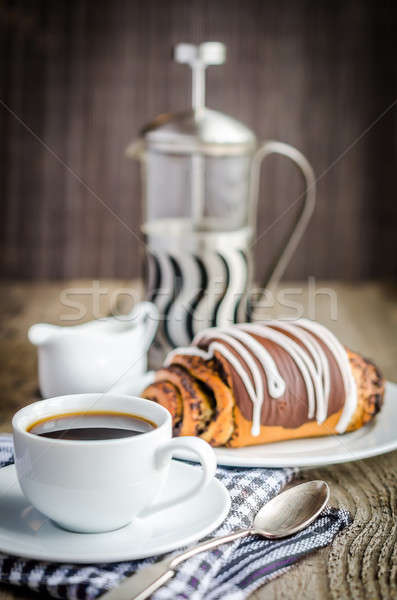 Cup of coffee and poppy bun glazed with ganache Stock photo © Alex9500
