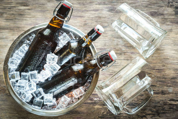 Bottles of beer in ice cubes Stock photo © Alex9500