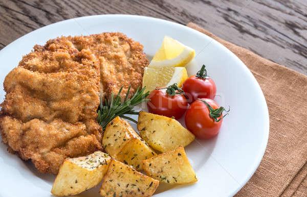 Portion of schnitzel with garnish Stock photo © Alex9500