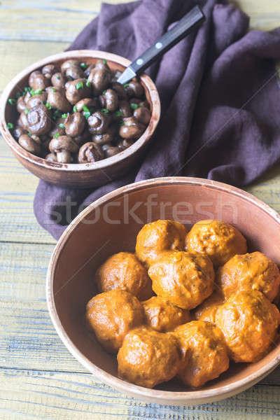 Bowl of turkey meatballs with roasted mushrooms Stock photo © Alex9500