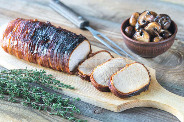 Pork loin wrapped in bacon with roasted mushrooms Stock photo © Alex9500