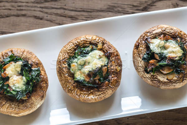Baked mushrooms stuffed with spinach and cheese Stock photo © Alex9500