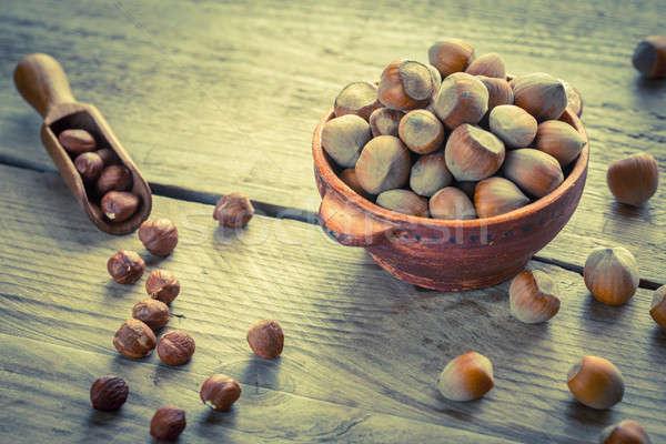 Rusztikus tál mogyoró fa asztal étel gyümölcs Stock fotó © Alex9500