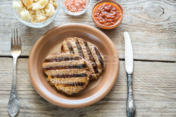 Beef steaks on the wooden background Stock photo © Alex9500
