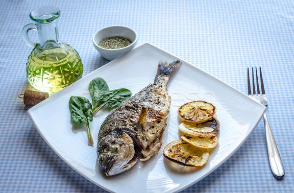 Grilled dorada fish with lemon and spinach Stock photo © Alex9500
