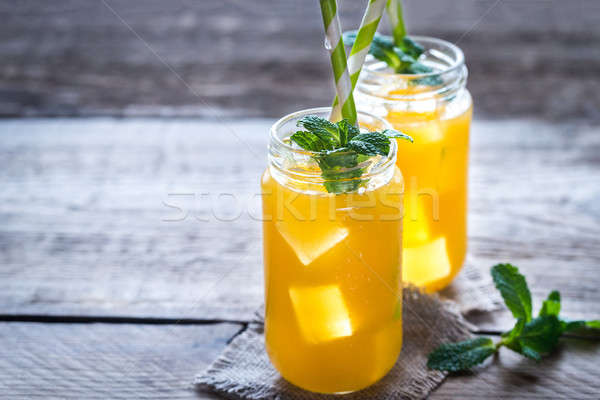 Glass jars of mango juice Stock photo © Alex9500