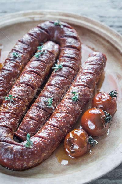 Pörkölt chorizo koktélparadicsom étel tányér hús Stock fotó © Alex9500