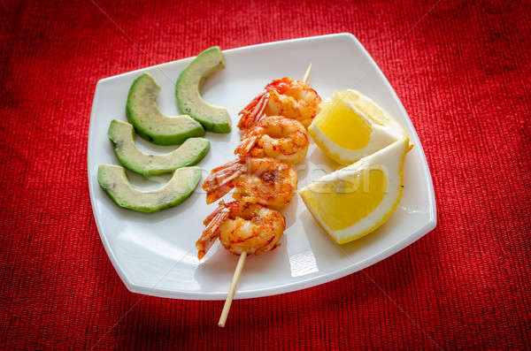 Shrimps skewers with avocado and lemon slices Stock photo © Alex9500