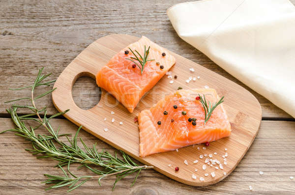 Raw salmon steaks on the wooden board Stock photo © Alex9500