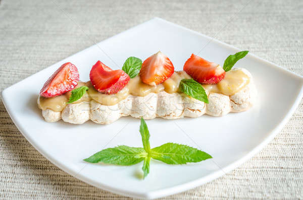 Meringue cake with cream and fresh strawberries Stock photo © Alex9500