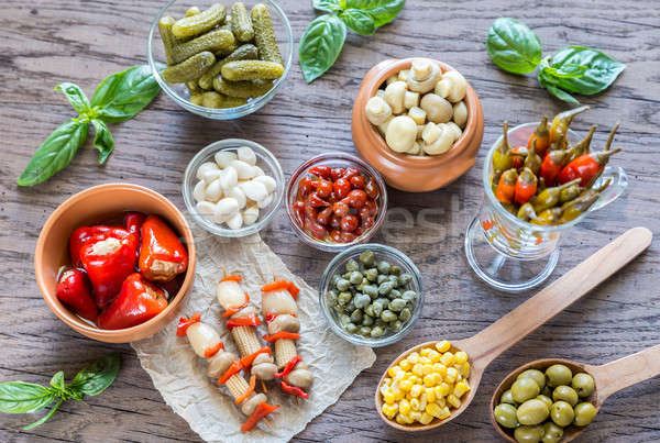 Pickled vegetables on the wooden background Stock photo © Alex9500