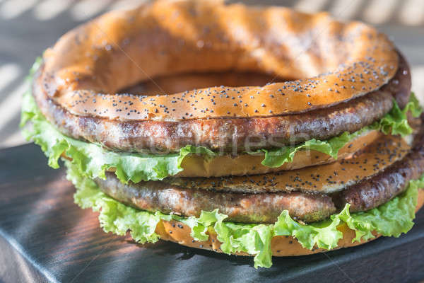 Bagels with fresh lettuce and fried sausage Stock photo © Alex9500