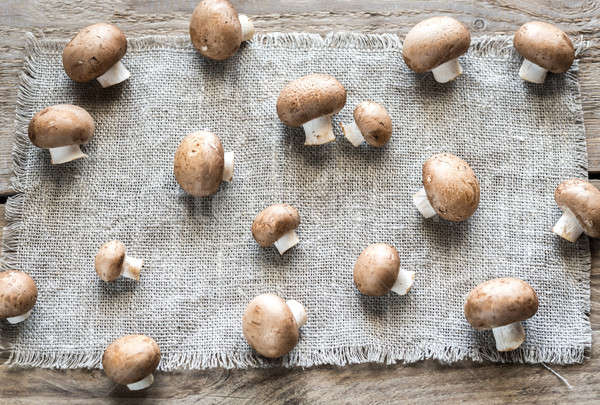 Brown champignon mushrooms on the canvas Stock photo © Alex9500
