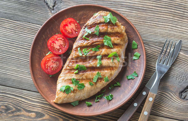 Grilled turkey breast with parsley and tomatoes Stock photo © Alex9500