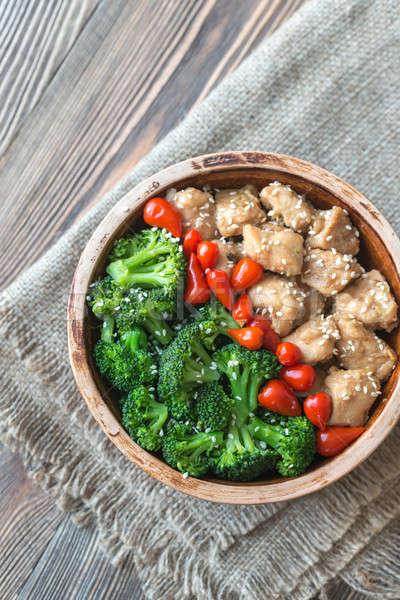 Bowl of broccoli and chicken stir-fry Stock photo © Alex9500