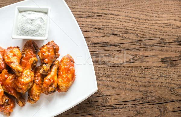 Portion of buffalo chicken wings Stock photo © Alex9500