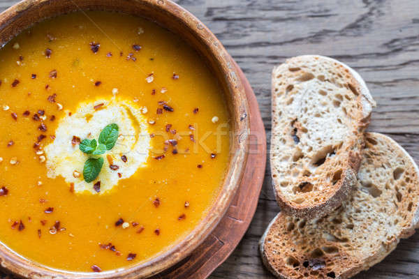 Bowl of spicy pumpkin cream soup: top view Stock photo © Alex9500
