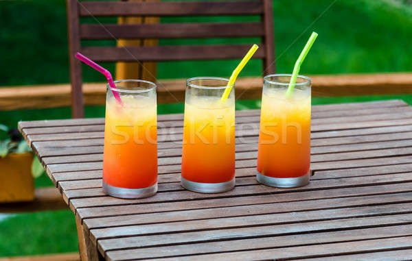 Trois tequila sunrise cocktails verre fond Photo stock © Alex9500