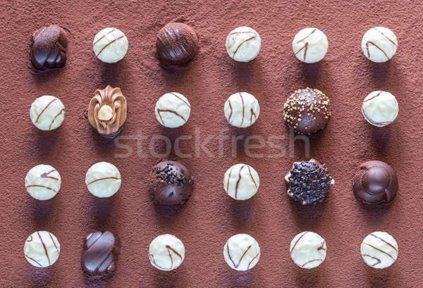 Chocolate candies on cocoa background Stock photo © Alex9500