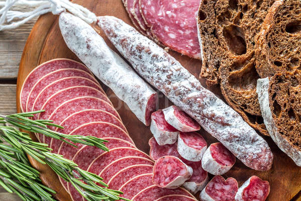 Stock photo: Different kinds of salami with dark-rye bread