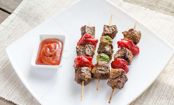 Grilled beef skewers with pepper and brussels Stock photo © Alex9500