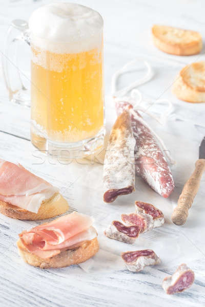 Mug of beer with sandwiches and smoked sausage Stock photo © Alex9500