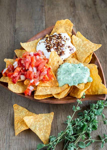 Sajt nachos különböző mártás zöld kövér Stock fotó © Alex9500