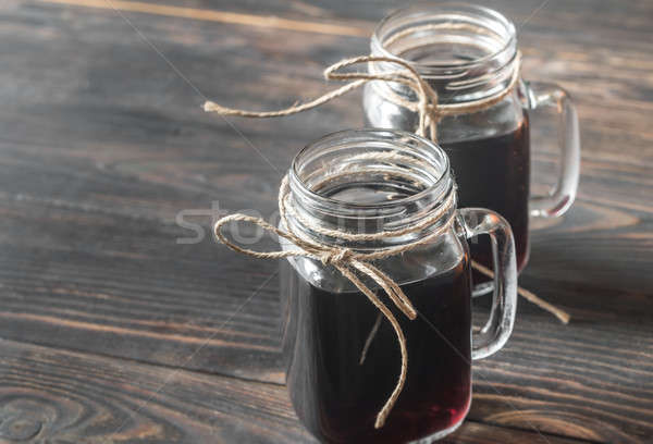 Two glasses of mulled wine on the wooden background Stock photo © Alex9500