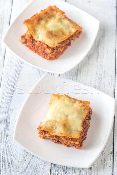 Adag lasagne fehér tányér sajt vacsora Stock fotó © Alex9500