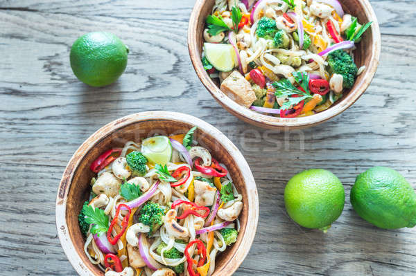 Two bowls of chicken noodle stir-fry Stock photo © Alex9500